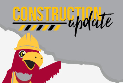Raider bird in a construction hat under the words construction update