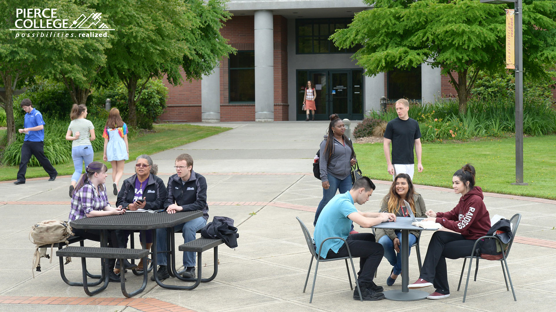 Pierce College students sitting at tables outside