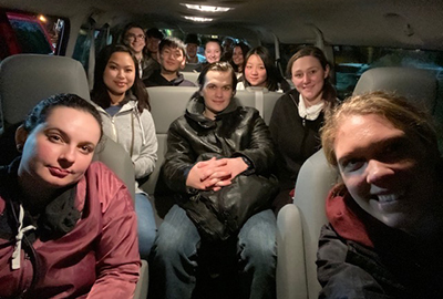 Pierce College students in a van on the way to a volunteer event.