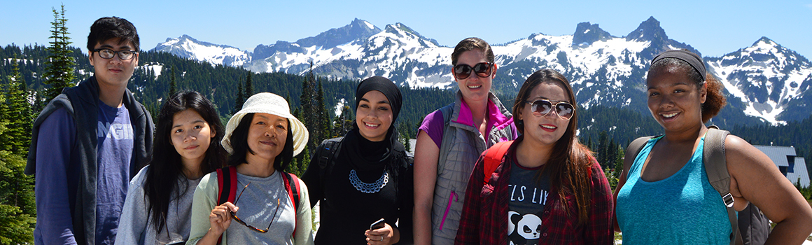 students with hiking gear outside with mount rainier in the background