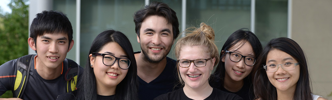 group of smiling international students
