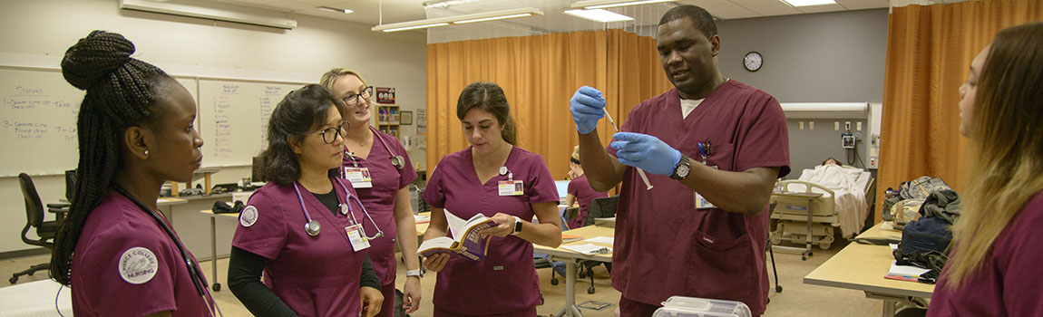 nursing students practicing treating a hospital patient