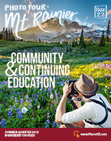 cover of summer 2019 bulletin with photographer taking a picture of mount rainier