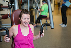 woman student working out on exercise machine