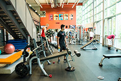 student in weight room in Puyallup health education center