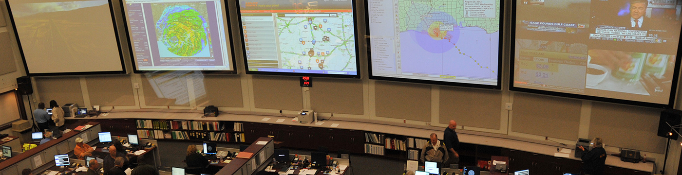 wall of monitors in emergency management center
