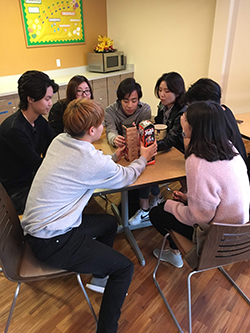 students playing game in residence hall kitchen