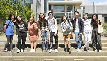 group of international students in front of cascade building
