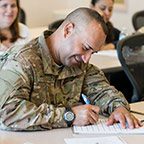Military student happily studying