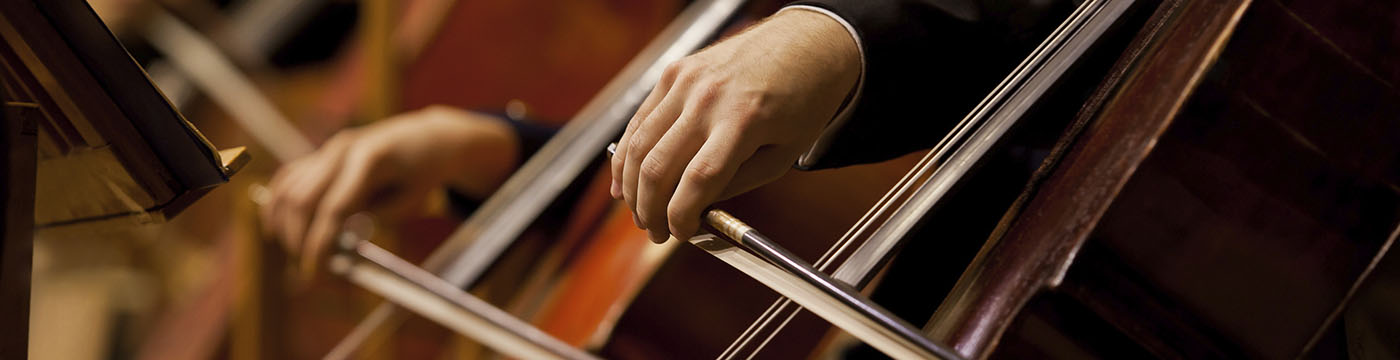 view of hands playing cellos