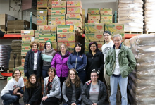 pierce employees and students volunteering at a food bank