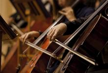 close up image of orchestra musicians at a concert
