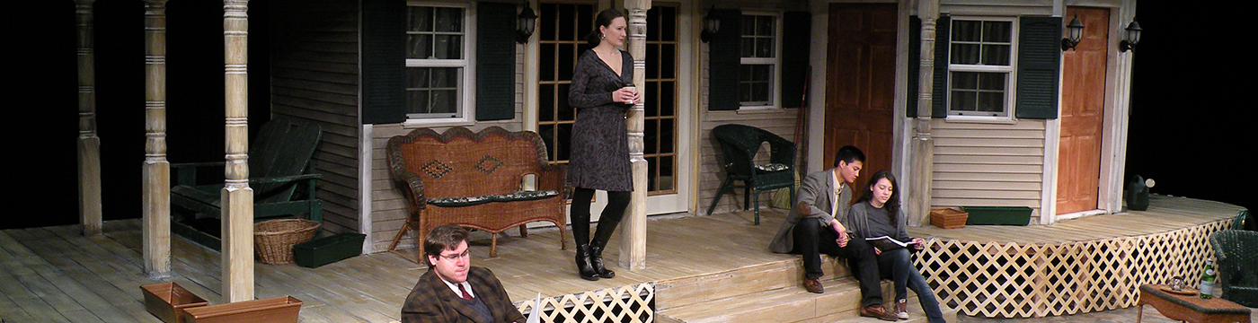 actors on a theatre set of a house porch